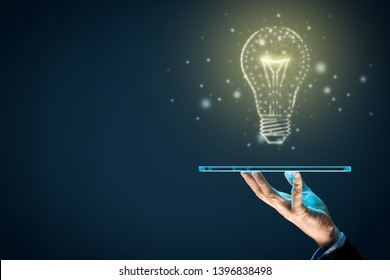 Artificial intelligence (AI) on digital tablet concept. Light bulb representing artificial intelligence and businessman holding futuristic tablet.