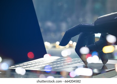 Artificial intelligence , chatbot , cyber communication , robot world and robo advisor. Robot finger point to laptop button with bokeh background.