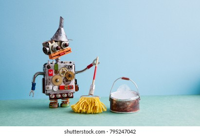 Artificial intelligence cleaning service concept. Robot washer with mop and bucket of water, mopping floor. Creative design toy funnel hopper, cogs wheels gears metallic body. Green blue background