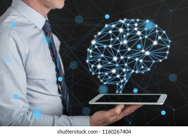 Artificial intelligence concept above a tablet held by a man