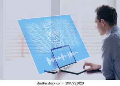 Artificial Intelligence concept with holographic robot face speaking to human on computer screen with binary code, machine learning and AI risks and threats, cyborg superintelligence taking control