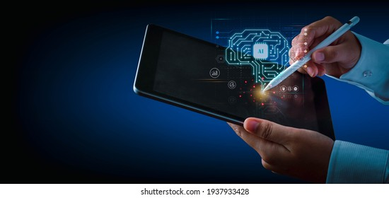 Artificial intelligence of futuristic technology concept. Hand using an electronic pen write on tablet screen virtual circuit AI brain genius technology.