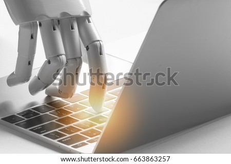 Artificial intelligence , robo advisor , chatbot , robotic concept. Robot finger point to laptop button with flare light effect.