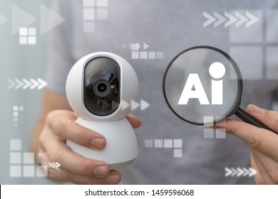 Artificial Intelligence Security Camera. Man hold secure 360 smart cam and magnifying glass with AI acronym.