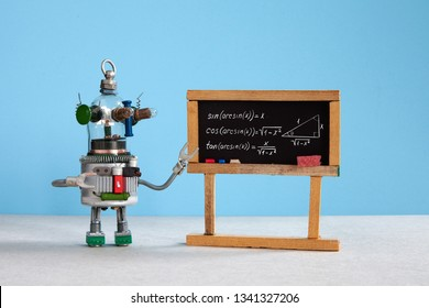 Artificial intelligence and trigonometry lesson in college. Robot teacher explains theory inverse trigonometric functions. Classroom interior with handwritten formula black chalkboard.