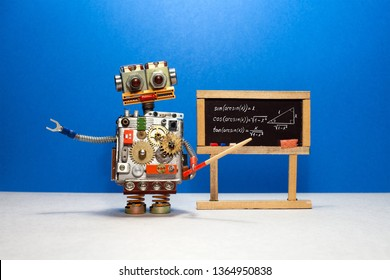 Artificial intelligence and trigonometry lesson in college. Robot teacher explains theory inverse trigonometric functions. Classroom interior with handwritten formula black chalkboard