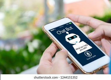 artificial intelligence,AI chat bot concept. Hands holding mobile phone on blurred abstract background. chatbot answering questions online, robot assistant help on website