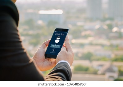 artificial intelligence,AI chat bot concept.close-up of Man hands holding mobile phone on blurred urban city as background