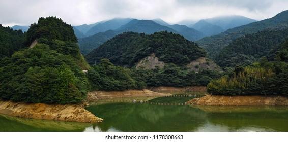 artificial lake dam reservoir and mountains landscape, Japan