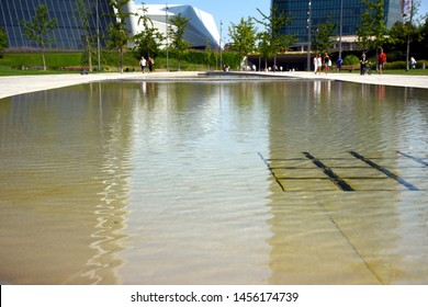 Artificial lake at Elsa Morante Square (Piazza Elsa Morante) with the reflection of the Generali and Allianz towers in the CityLife district of Milan