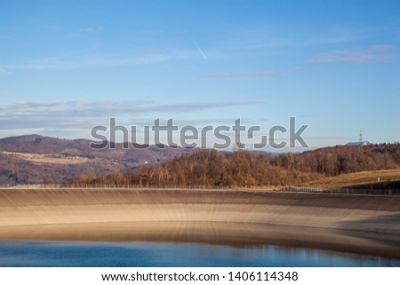 Artificial lake of pumping hydroelectric power plant and a landscape behind it
