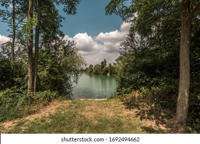 Artificial lake surrounded by trees and vegetation near the village of Kork. Bathing and fishing are allowed.