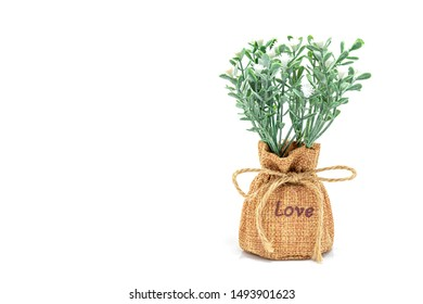 Artificial lavender in burlap, with isolated on white background. Great to use for decorating weddings or party decoration. Copy space, Selective focus.
