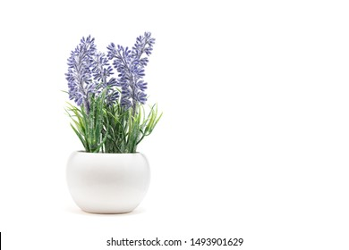 Artificial lavender flower bouquet with white vase for home or party decoration isolated on white background. Copy space, Selective focus.