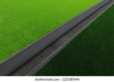 Artificial lawn laying at sports field