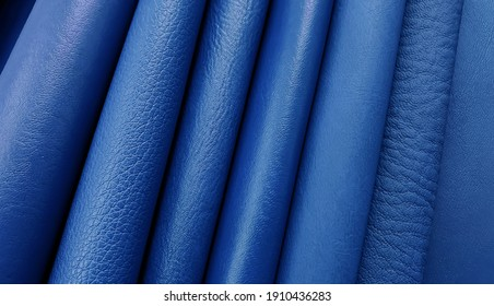Artificial leather in variety shades of blue colors and variety pattern of texture for classic mood. abstract blue leather sample catalog background.