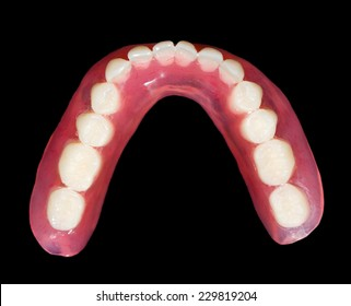 Artificial lower denture on isolated  black background