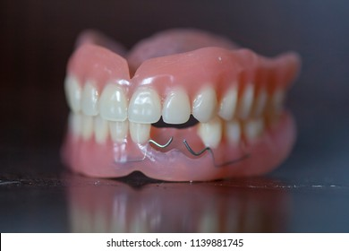 The artificial medical denture on black background