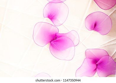 Artificial orchid made from fabric for the background.