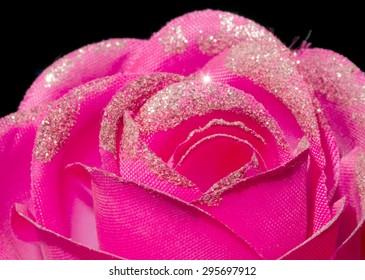 Artificial Pink Rose on black background