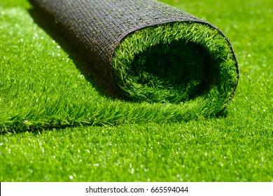 artificial rolled green grass; closeup