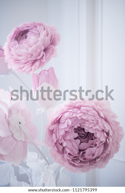 Artificial rose made of pink paper, great as the decor on the stand