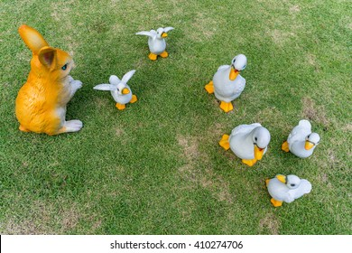 Artificial sculptured ducks and rubbit garden decoration on the grass