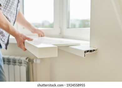 Artificial stone window sill, installation, technological process. Repair, construction of house, apartment. Close up of worker's hand with tools and parts
