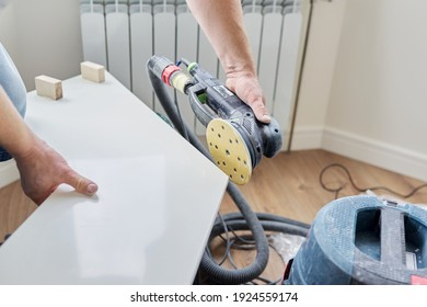 Artificial stone window sill, installation, technological process. Repair, construction of a house, apartment. Close-up shot of a builder grinds a window sill using a grinder