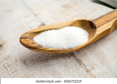 Artificial Sweeteners and Sugar Substitutes in wooden spoon. Natural and synthetic sugarfree food additive:  sorbitol, fructose, honey, Sucralose, Aspartame