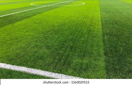 Artificial turf of soccer football field with white stripe