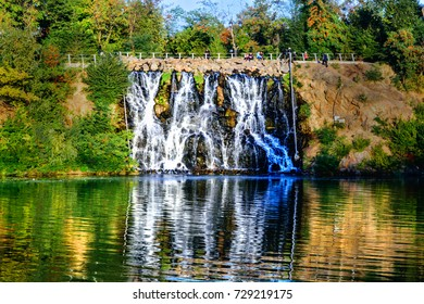 Artificial Waterfall on Monastyrsky Island in the city of Dnepr on the river.. Dnepropetrovsk, Dnipropetrovsk, Dnipro city, Ukraine. Sunny Autumn day.