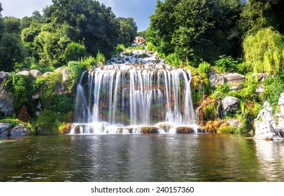 Artificial waterfall and statue at the garden of Palace of Caserta in southern Italy