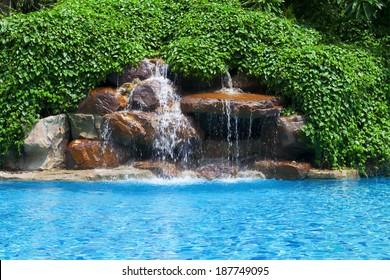 Artificial waterfall in swimming pool