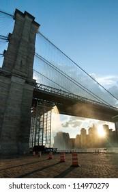Artificial Waterfalls under Brooklyn Bridge in New York City, USA. vertical composition.