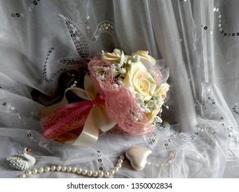Artificial Wedding Bouquet of Milk Roses in Pink Sisal Packaging