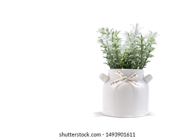 Artificial white flower bouquet with white vase for home or party decoration isolated on white background. Copy space, Selective focus.
