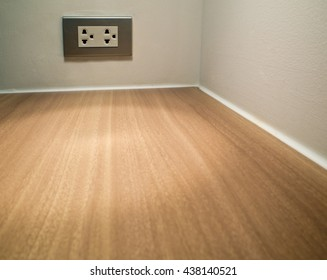 Artificial wood texture on conner of table and Electrial socket