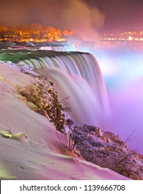 Artificially illuminated Niagara Falls at night, during winter, from Prospect Point