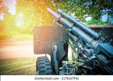 Artillery cannon gun / ordnance for soldier warrior in the world war in the park - old Artillery cannon camouflage pattern
