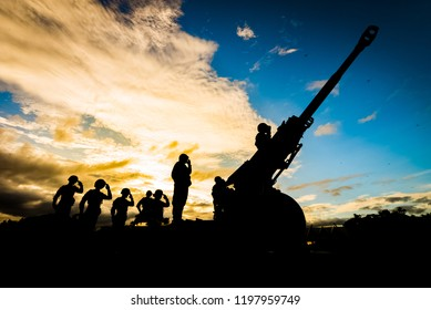 Artillery Cannon Gun And Artillery Soldier. Artillery Silhouette background.