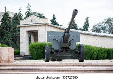 Artillery canon near Tomb of the Unknown Soldier in The Mausoleum Of Romanian Heroes in Carol Park, Bucharest Romania