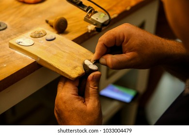 Artisan Crafting a Cameo From A Shell
