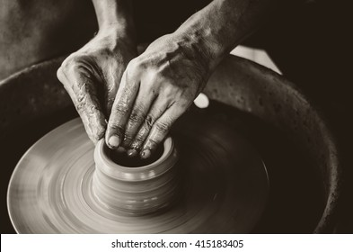 Artisan hands making clay pot