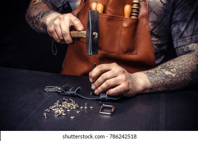 Artisan of leather produces leather goods