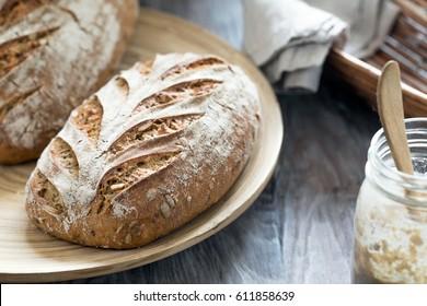 Artisan rye sourdough bread in rustic composition