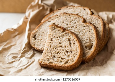 Artisan Sliced Homemade Sourdough Bread Slices with Paper Bag / Package or Craft Paper.
