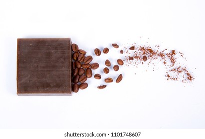artisan soap bar of coffee with powdered coffee beans on white background without animal fats, vegan coffee and aromatherapy care of skin and body, health and natural