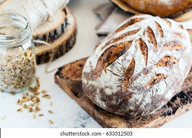 Artisan sourdough bread with sprouted rye in bright rustic composition