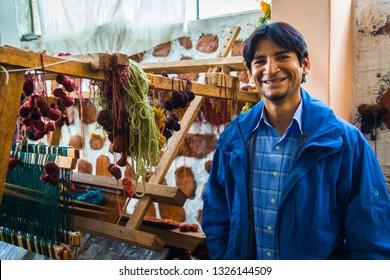 Artisan weaver working in his workshop, March 2014, Ayacucho Peru
